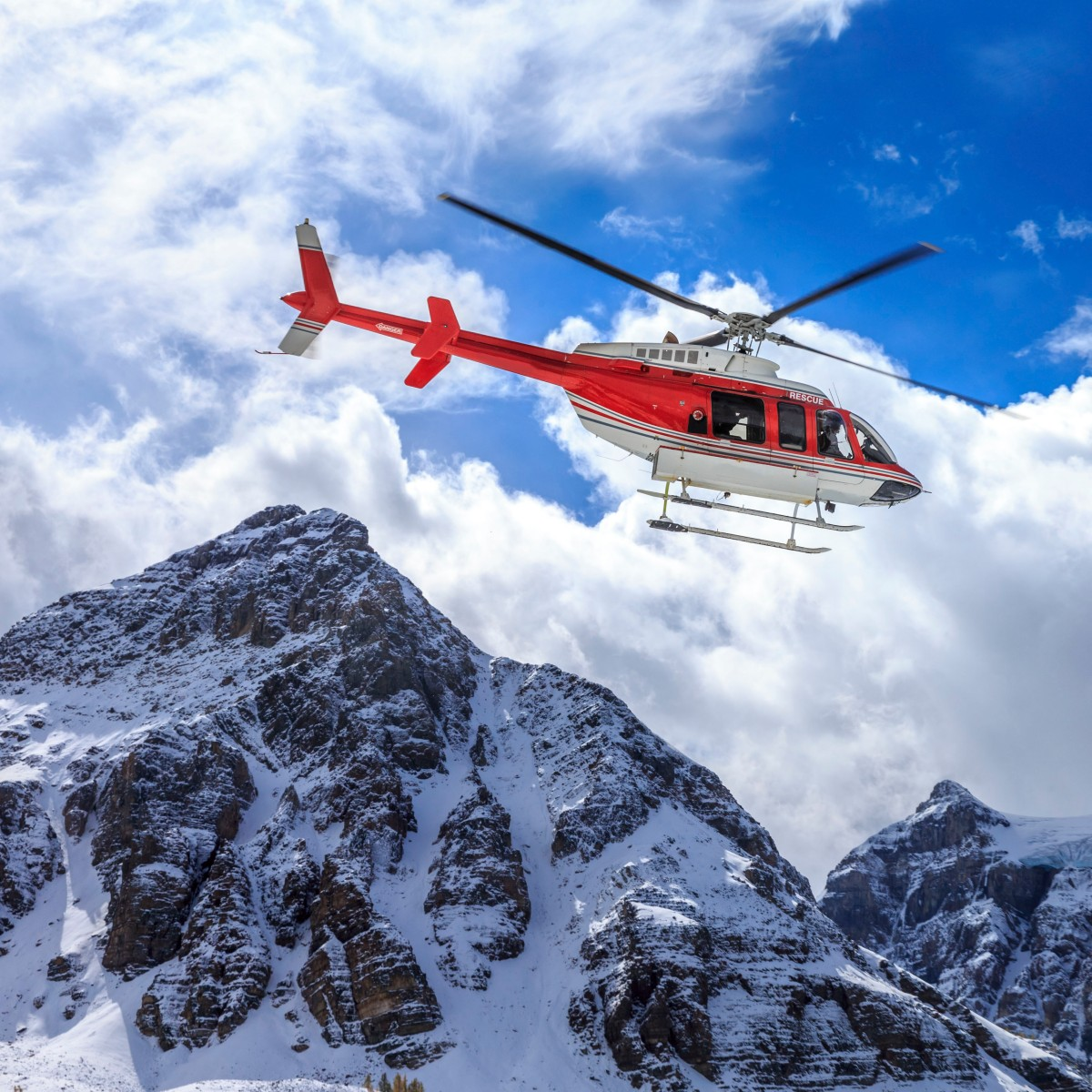 Helicopter Flying Over Mountains
